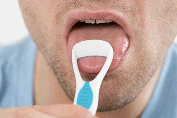 using a tongue cleaner